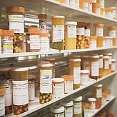 Pictures of Pill bottles in medicine cabinet (focus on dietary ...