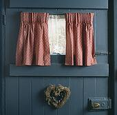 Stock Photography Of Blue Curtains On Portiere Rods On Awkwardly Shaped Dormer Window U26110301
