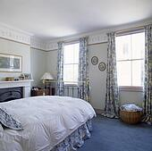 stock photo of white curtains at window beside large white